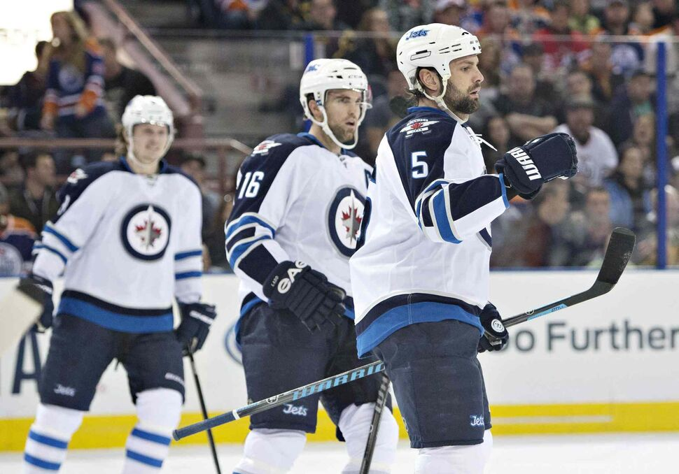 Winnipeg Jets' Jacob Trouba (8), Andrew Ladd (16) and Mark Stuart (5) celebrate a goal against the Edmonton Oilers during first period NHL hockey action in Edmonton, Alta., on Monday. (Jason Franson / The Canadian Press)