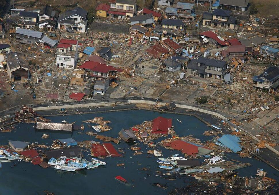 Wrecked ships, houses and debris float in the sea in Kesennuma, Miyagi Prefecture, Sunday, March 13, 2011 after Japan's biggest recorded earthquake hit its eastern coast Friday. (AP Photo/Itsuo Inouye)