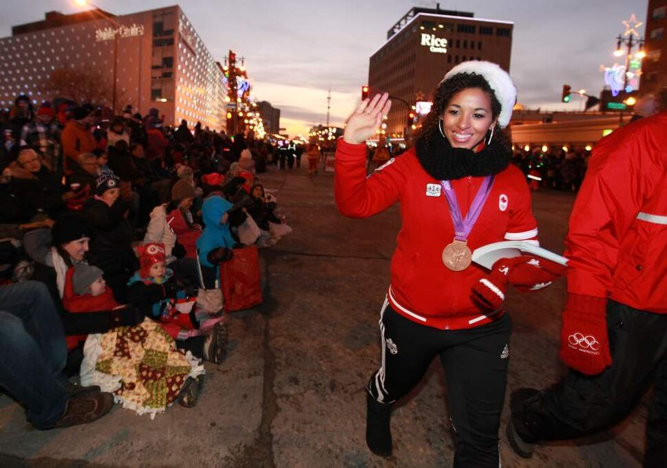 Olympic medalist Desiree Scott waves to the crowd. (Ruth Bonneville/Winnipeg Free Press)