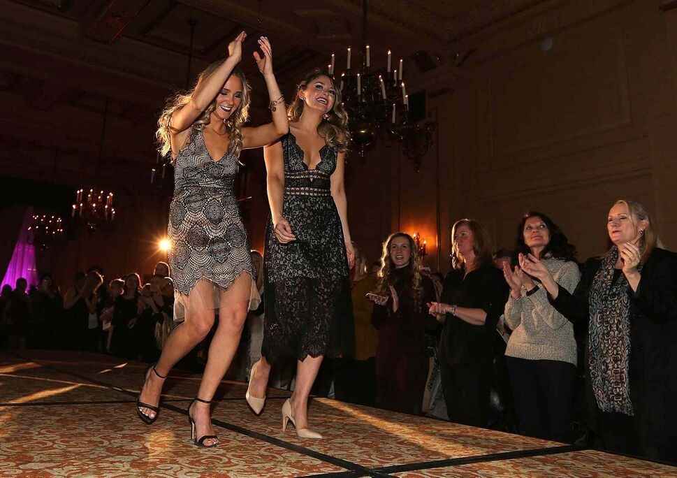 JASON HALSTEAD / WINNIPEG FREE PRESS</P><p>Event organizers Ashely Tokaruk (left) and Madelaine Lapointe salute the crowd at the Runway to Change fashion show fundraiser presented by Qualico in support of Main Street Project on Feb. 2, 2017, at the Fort Garry Hotel.