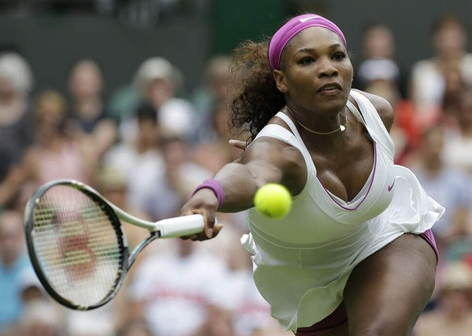 Serena Williams of the United States plays a return to Melinda Czink of Hungary during a second round women's singles match at the All England Lawn Tennis Championships at Wimbledon, England. (AP Photo/Anja Niedringhaus)