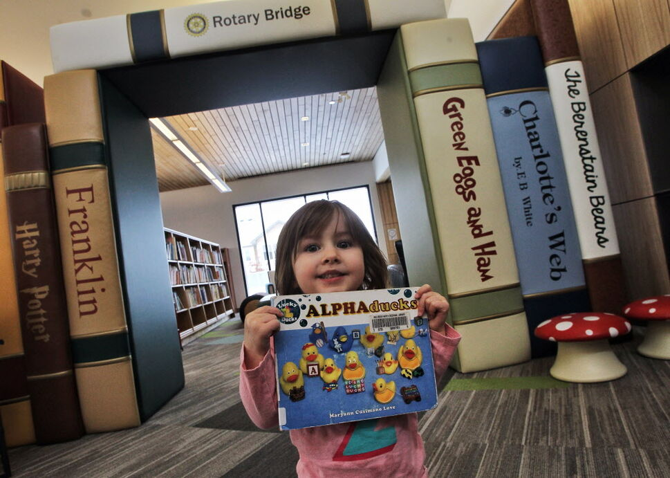 Evy Galashan, 2, shows a favorite book while at the recently opened Gaynor Family Regional Library in Selkirk, Manitoba, with a $1.5 m donation from the Gaynor family. MIKE DEAL / WINNIPEG FREE PRESS (WINNIPEG FREE PRESS)