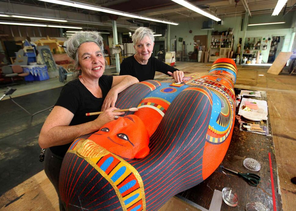 Kim Forrest (left) and Anne Armit pose with their colourful creation for the Manitoba Museum's Mummy of Pesed exhibit. (Ruth Bonneville / Winnipeg Free Press)