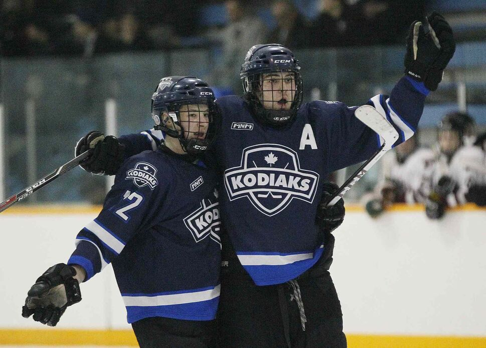 The River East Kodiaks Holden Band (left) and Tristan Beach celebrate Beach's goal against the St. Paul's Crusaders. (JOHN WOODS / WINNIPEG FREE PRESS)