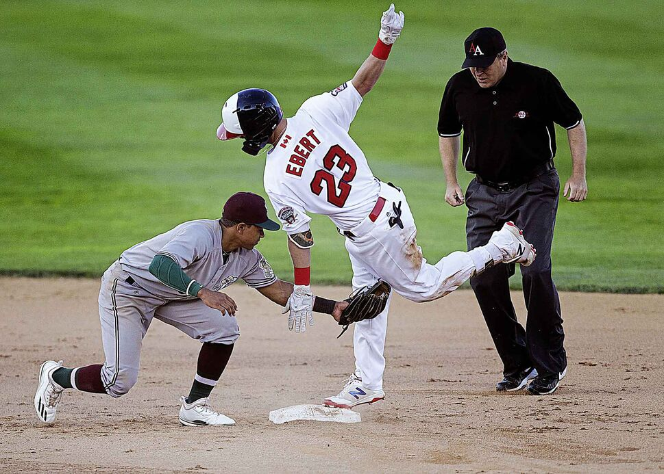 PHIL HOSSACK / WINNIPEG FREE PRESS</p><p>Gary SouthShore RailCats shortstop Andy DeJesus reaches out too late to tag Winnipeg Goldeyes Jordan Ebert at second base Wednesday evening at Shaw Park, June 12, 2018.</p>