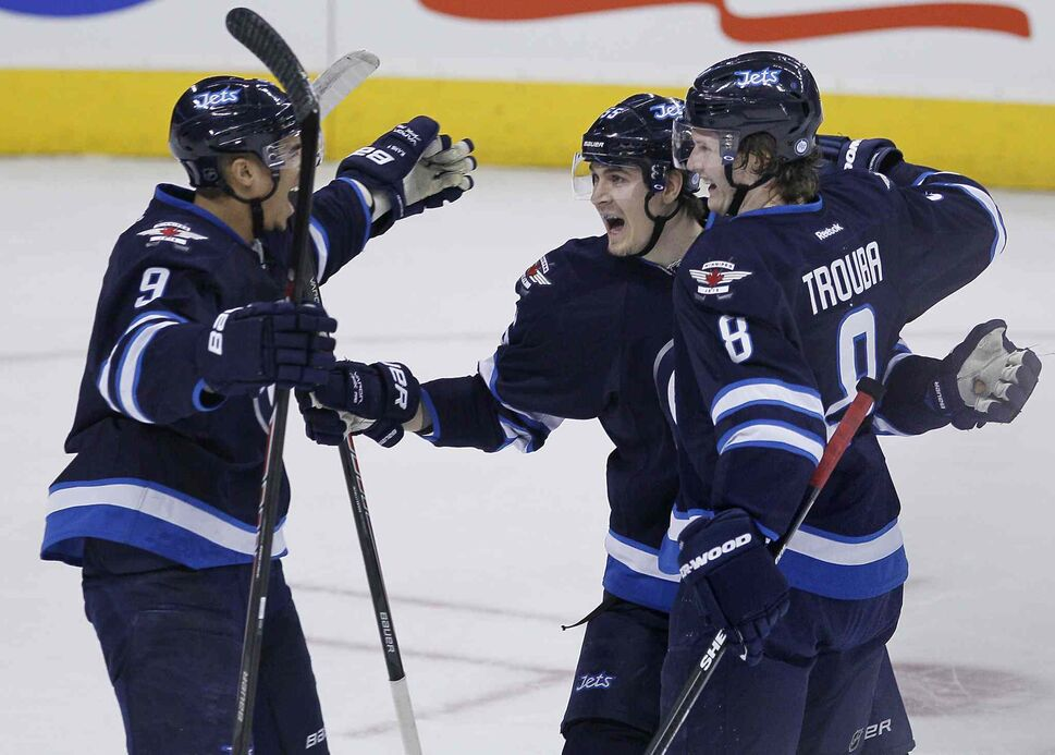 Winnipeg Jets' Evander Kane (9), Mark Scheifele (55) and Jacob Trouba (8) celebrate Trouba's goal against the Florida Panthers during the first period. (John Woods / The Canadian Press)