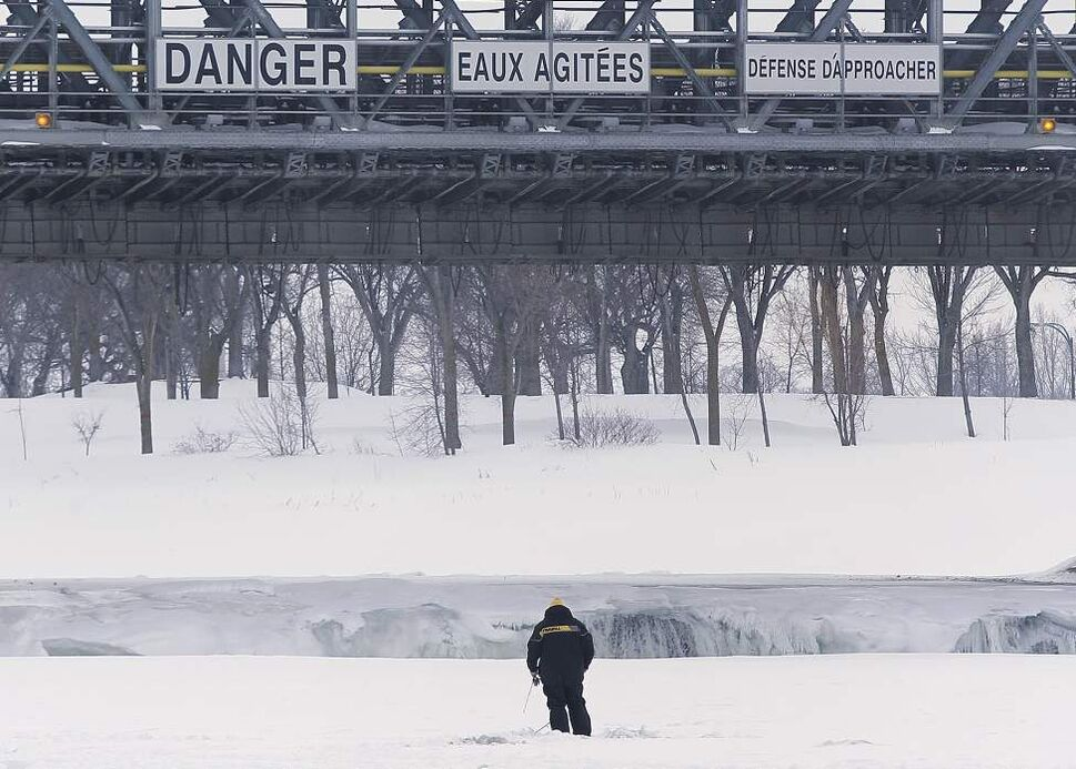 An ice fisher drops a line just north of Lockport. March 9, 2014. 