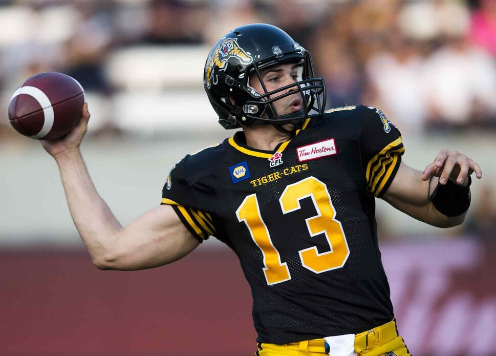 Hamilton Tiger-Cats' quarterback Dan LeFevour makes a pass against the Winnipeg Blue Bombers' during the first half. (Nathan Denette / The Canadian Press)