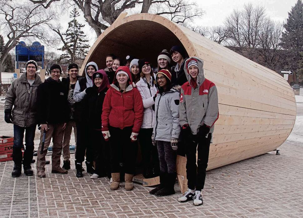 SHELDON BIRNIE/CANSTAR FILES A Grade 11 art class at Mennonite Brethren Collegiate Institute with the warming hut they designed.