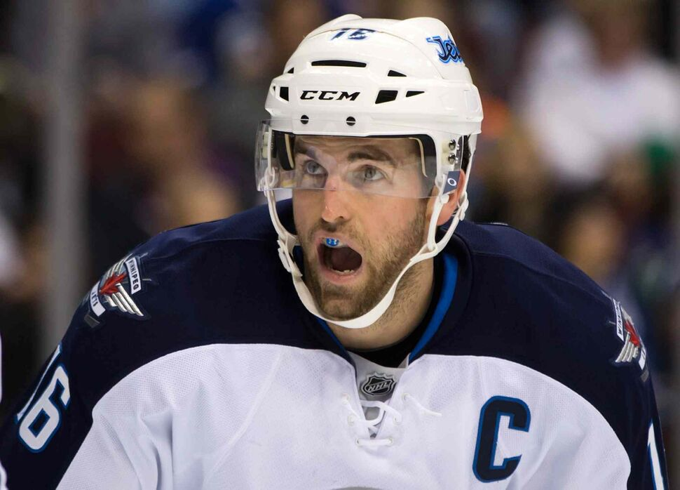 Winnipeg Jets captain Andrew Ladd lines up for a faceoff during the first period. (DARRYL DYCK / THE CANADIAN PRESS)