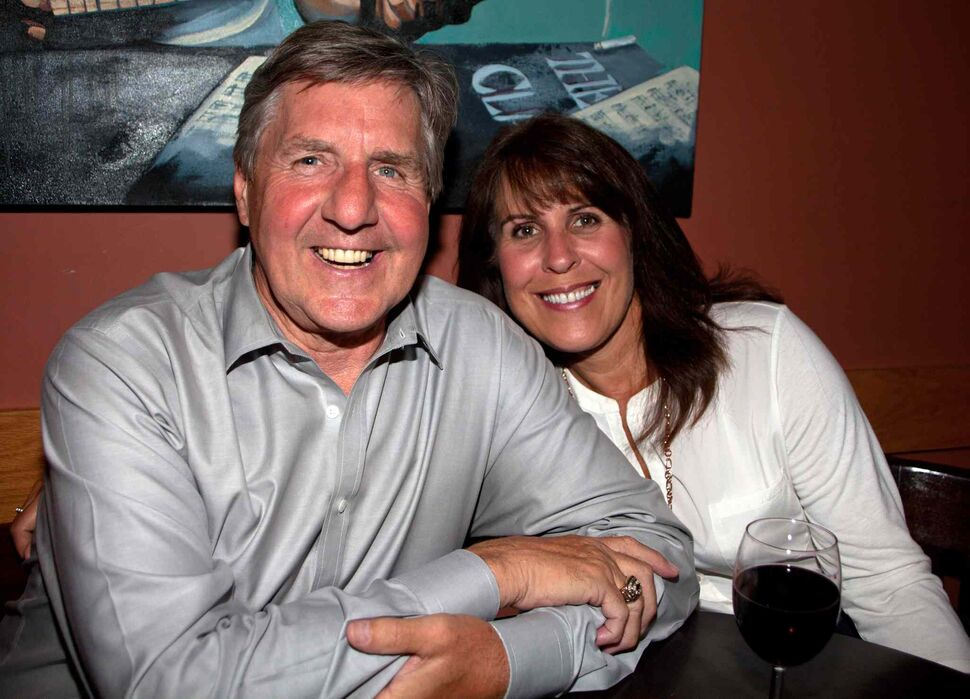A surprise 50th birthday party for POP Sports & Entertainment's Dave Sherman was held Aug. 7, 2015 at Le Garage Café. Pictured are Perry Miller and Valerie Yuel-Miller. (JOHN JOHNSTON / WINNIPEG FREE PRESS)