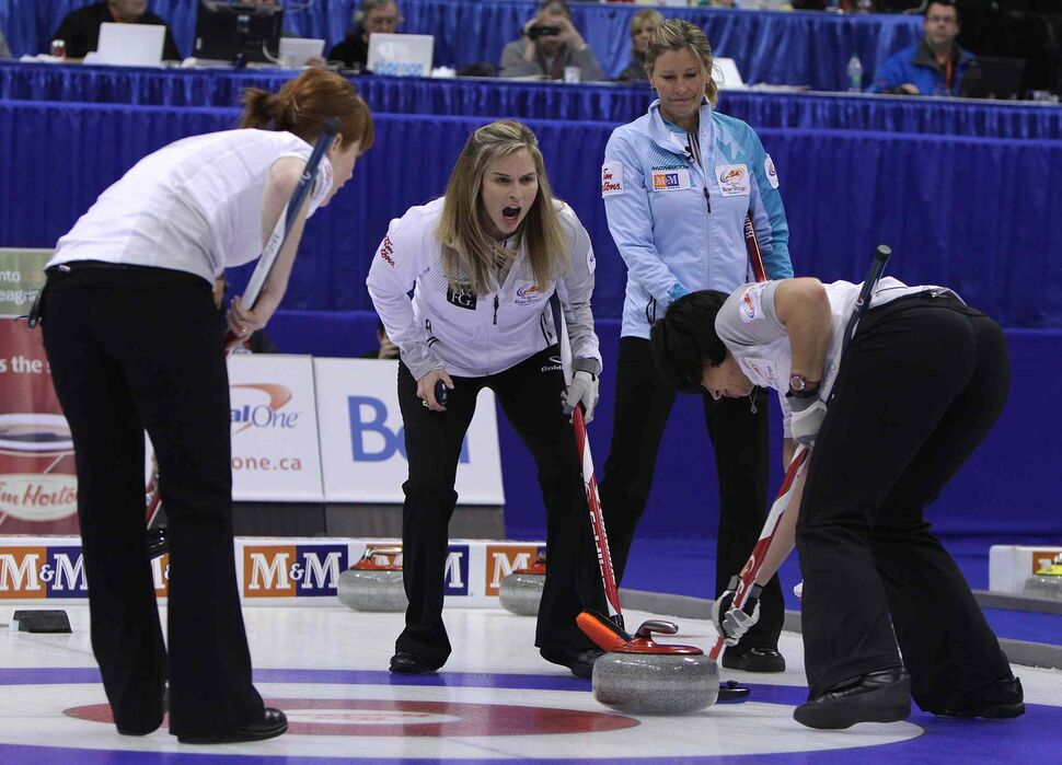 Skip Jennifer Jones (centre left) calls on her sweeper Jill Officer (right) during action as Sherry Middaugh (right) looks on. (Jason Halstead / Winnipeg Free Press)