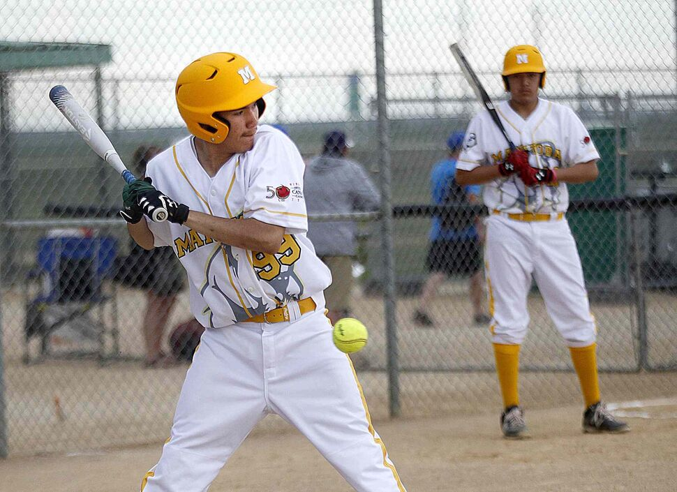 PHIL HOSSACK / WINNIPEG FREE PRESS</p><p>Team Manitoba batter Damien Anderson leans out from an inside pitch as Manitoba's first event at the Canada Games got underway at Bloomberg Park Saturday, July 29, 2017.</p>