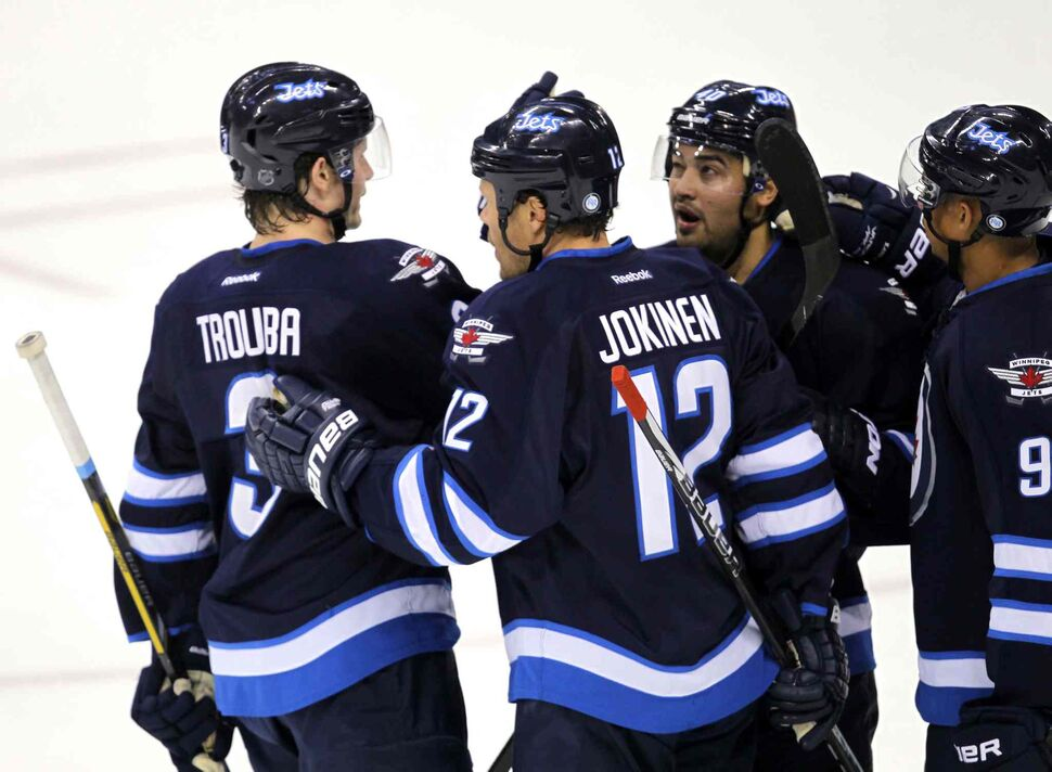 From left: Jacob Trouba, Olli Jokinen, Devon Setoguchi and Evander Kane convene after Setoguchi scored for the Jets in the first period. (BORIS MINKEVICH / WINNIPEG FREE PRESS)