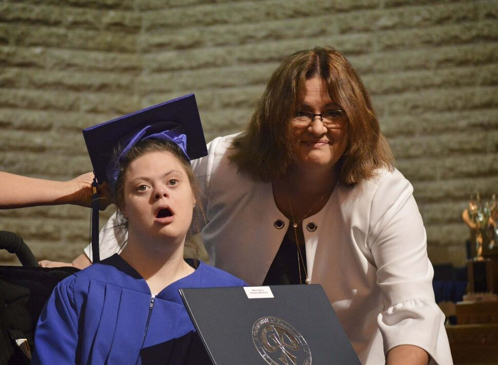 Mary Rollason-MacAulay, left, with Grant Park High School Principal Susan Anderson, has taught others to interact with the person first instead of focusing on the disability. (KEVIN ROLLASON / WINNIPEG FREE PRESS)