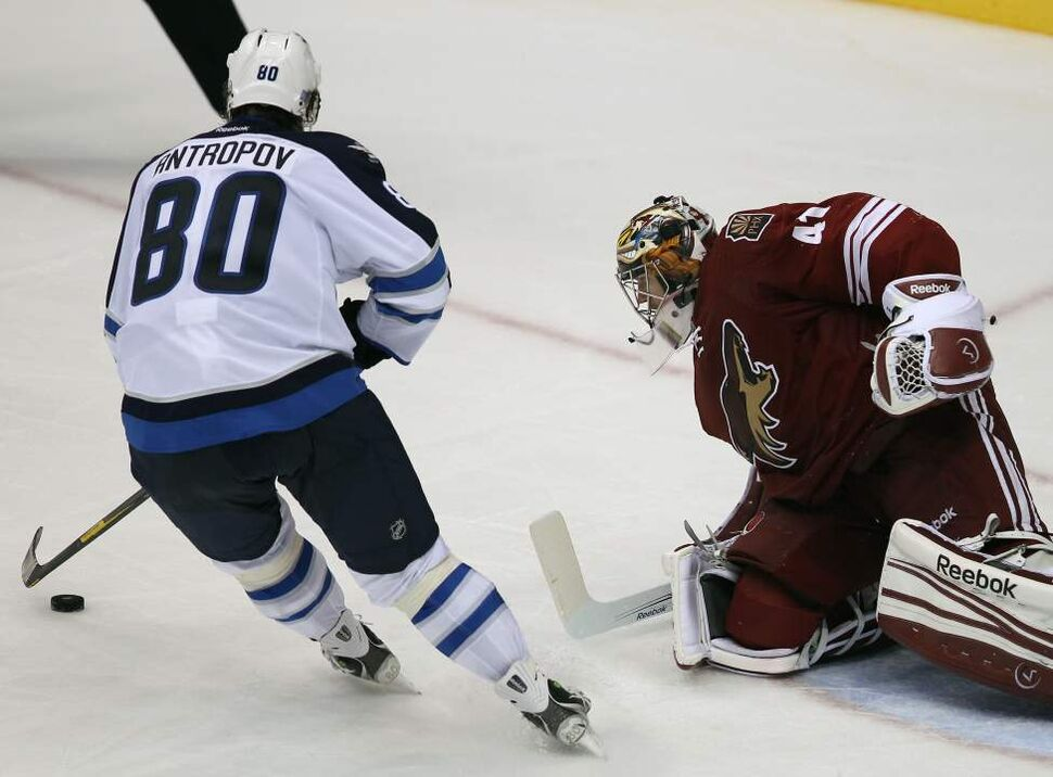 Winnipeg Jets' Nik Antropov, left, goes wide and misses his chance on a penalty shot on Phoenix Coyotes Mike Smith during third period  action Saturday at the Jobing.com Arena in Glendale, Arizona. The Coyotes beat the Winnipeg Jets 4-1.   (JOE BRYKSA / WINNIPEG FREE PRESS)