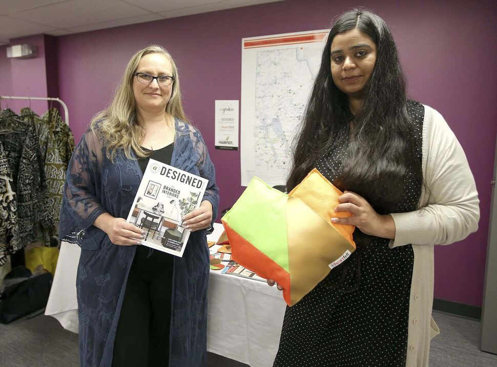 Yoko Chapman of Ayoko Design (left) and Rubab Fatima, Cutting Edge sales and marketing specialist, share products from the Cutting Edge Heartfelt line.</p></p>