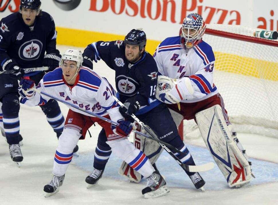 Winnipeg Jets' Tanner Glass gets in between some New York Rangers in first period action. Oct. 24, 2011 (BORIS MINKEVICH / WINNIPEG FREE PRESS)