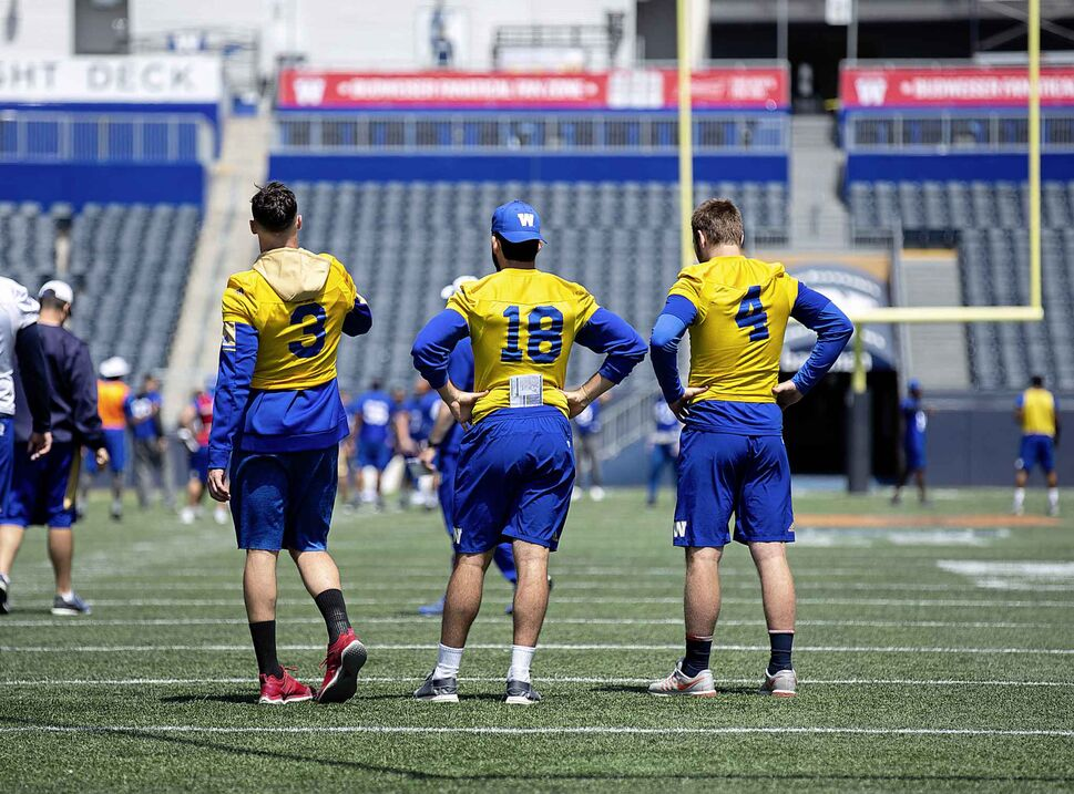 ANDREW RYAN / WINNIPEG FREE PRESS</p><p>Blue Bombers quarterbacks Bryan Bennett (from left), Alex Ross, and Zack Mahoney stand together during a Bomber practice at Investors Group Field Thursday, June 7, 2018.