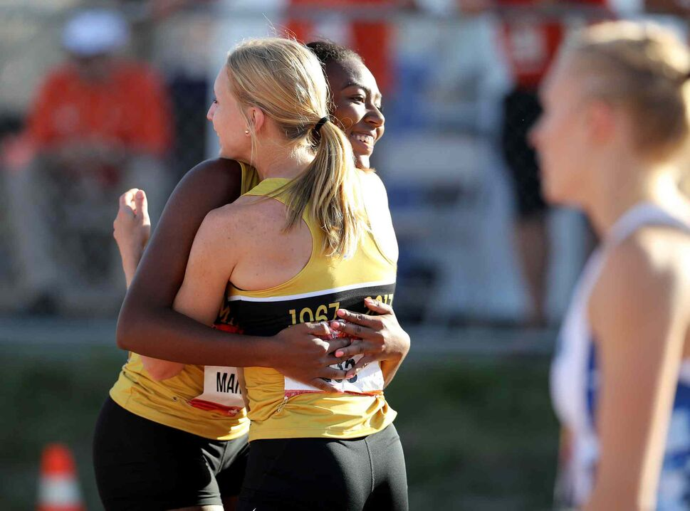 TREVOR HAGAN / WINNIPEG FREE PRESS</p><p>Brianna Tynes and Tegan Turner celebrate after the 4x400m race as Manitoba wins bronze, Thursday, Aug. 3, 2017.</p>