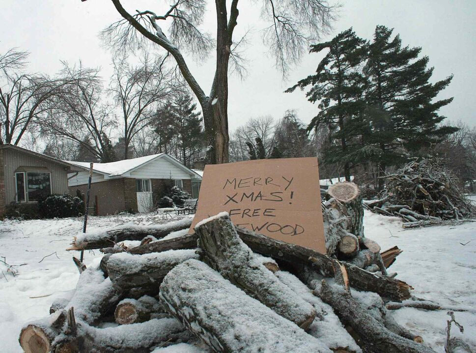 Free firewood is offered up by a roadside in Oakville, Ont., Wednesday, Dec.25, 2013. The branches fell from trees damaged during last weekend's ice storm.  (The Canadian Press)