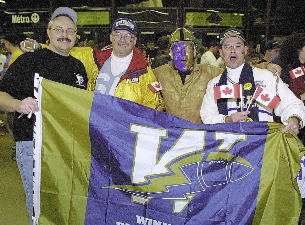 Winnipeggers Wally Starodub (from left), Howard Skrypnyk, Garry Minsky and Steven Skrypnyk are ready to cheer on the Blue Bombers when the team faced the Calgary Stampeders in the Grey Cup at Olympic Stadium in Montreal in 2001.  The Bombers lost 27-19.  (WINNIPEG FREE PRESS ARCHIVES)
