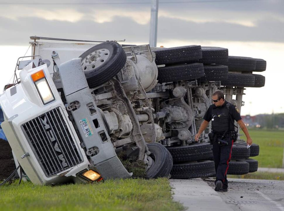A semi hauling dirt flipped over at the intersection of Lagimodiere Blvd and Chief Peguis Trail. September 4, 2014
