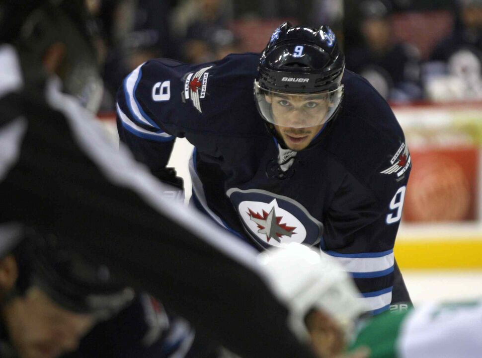 Evander Kane keeps his eyes on the puck during a faceoff in the second period. (JOE BRYKSA / WINNIPEG FREE PRESS)