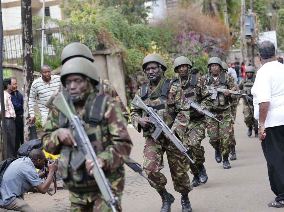 Soldiers arrive at Westgate Mall in Nairobi, Kenya, Saturday. A gun battle inside the shopping centre left several people dead after gunmen attacked one of the city's most exclusive malls. (Tribune Media MCT)