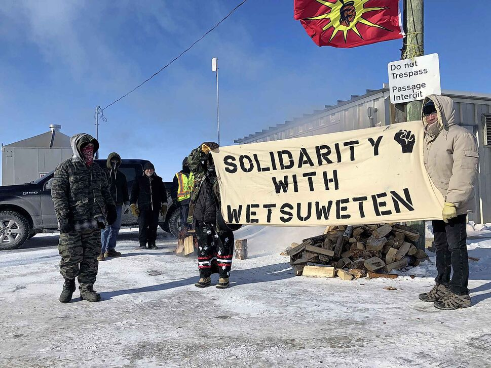 Demonstrators block a portion of the Canadian National rail line just north of Wilkes in Diamond on Wednesday morning, in solidarity with ongoing efforts to block a pipeline on traditional Wet'suwet'en territory in British Columbia.  (Danielle DaSilva / Winnipeg Free Press)