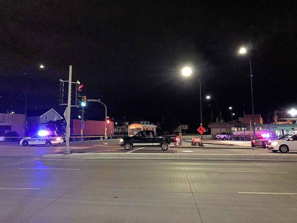 Logan Avenue was closed at McPhillips following an early-morning collision. (MAGGIE MACINTOSH / WINNIPEG FREE PRESS)