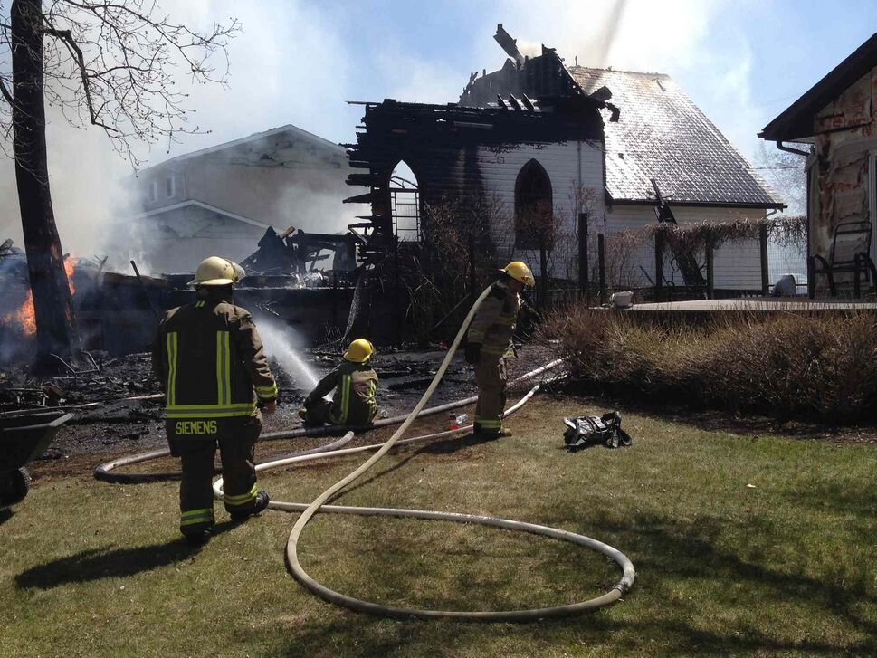 Firefighters douse the flames of the fire that destroyed the 110-year-old United Church in the community of Starbuck this afternoon. The blaze began shortly after lunch, and fire crews from the RM of Macdonald and neighbouring municipalities responded. (Joe Bryksa / Winnipeg Free Press)