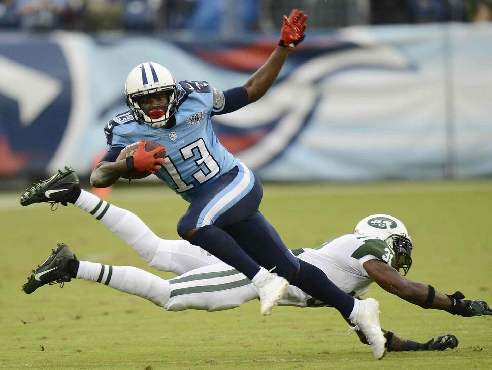 Tennessee Titans wide receiver Kendall Wright gets past New York Jets cornerback Antonio Cromartie during the Titans 38-13 victory, Sunday in Nashville. (Mark Zaleski / The Associated Press)