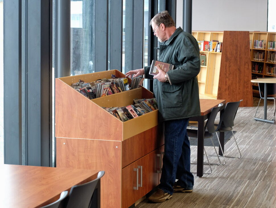 Ted Bakker browses through the DVD selection at the recently opened Gaynor Family Regional Library in Selkirk, Manitoba, with a $1.5 m donation from the Gaynor family.  MIKE DEAL / WINNIPEG FREE PRESS (WINNIPEG FREE PRESS)