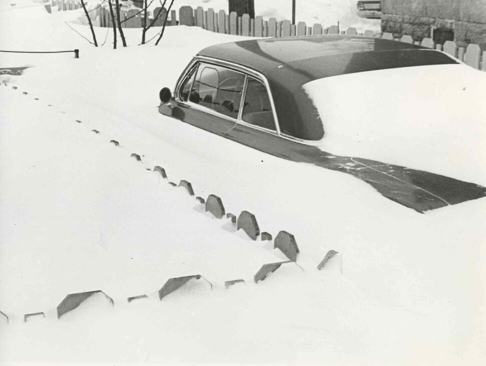 A car on Wolseley is covered in the 1966 blizzard. (Gerry Cairns / Winnipeg Free Press files)