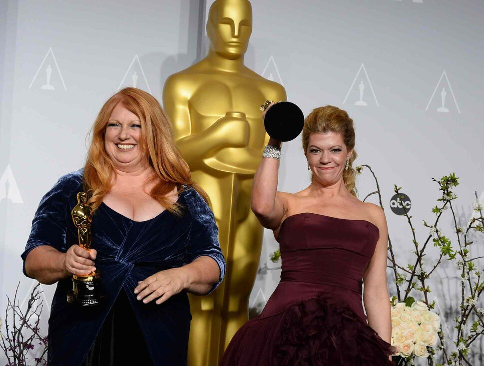 Adruitha Lee, left, and Robin Mathews pose with their Academy Awards for best makeup and hairstyling for Dallas Buyers Club. (Jordan Strauss / The Associated Press)