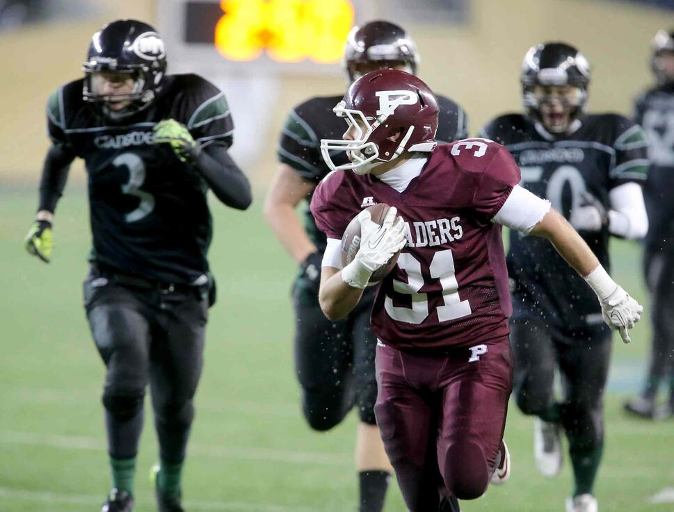 Austin Coutts of the St. Paul's Crusaders runs for an easy touchdown. (Trevor Hagan / Winnipeg Free Press)