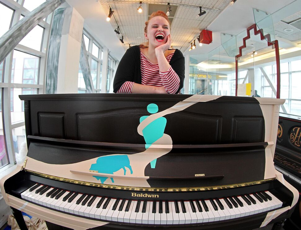 Chloe Cafe a visual artist at Studio 393 located in the overhead walkway between The Bay and Portage Place, displays her Juno-themed piano she painted, one of the seven pianos placed in a public space in downtown Winnipeg to be used and enjoyed at will by Winnipeggers.   (Ruth Bonneville / Winnipeg Free Press  )