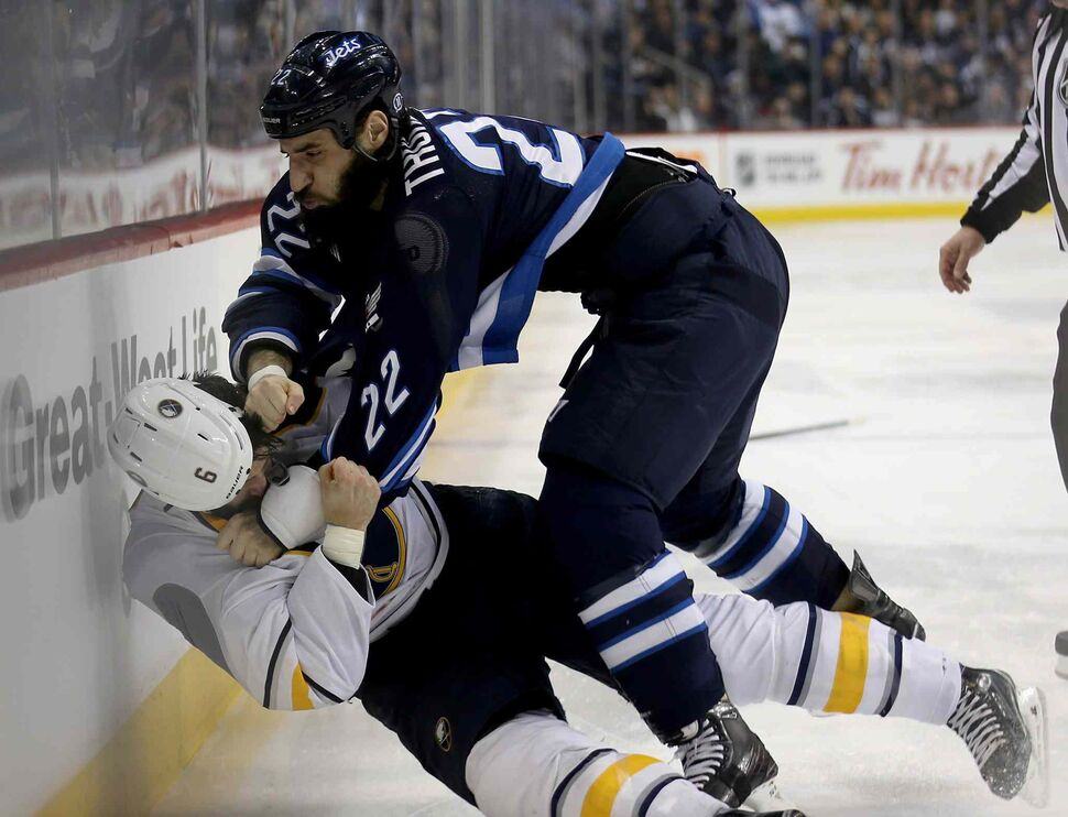 Winnipeg Jets' Chris Thorburn (22) knocks Buffalo Sabres' Mike Weber (6) while fighting during the second period. (Trevor Hagan / The Canadian Press)
