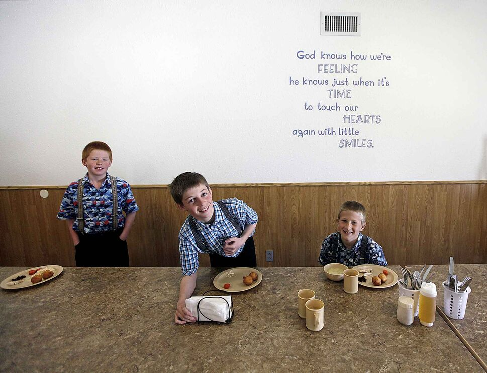 PHIL HOSSACK/ WINNIPEG FREE PRESS</p><p>Three young elementary students at the James Valley Hutterite Colony settles into their lunch in the children's dining room. Children ranging in age of 5 -15, eat separately from their parents who dine in a separate room at the community's main kitchen hall. One of the original Hutterite settlements in Manitoba, the James Valley community celebrates its 100th anniversary this year.</p>