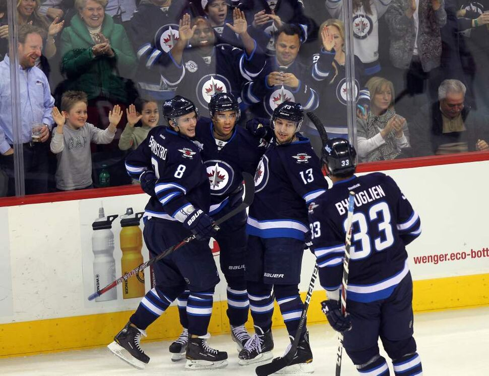 Winnipeg Jets' Evander Kane celebrates with Kyle Wellwood (#13) Alexander Burmistrov (#8) and Dustin Byfuglien (#33) after scoring his 25th goal during their game against the Florida Panthers. March 1, 2012 - (Phil Hossack / Winnipeg Free Press)