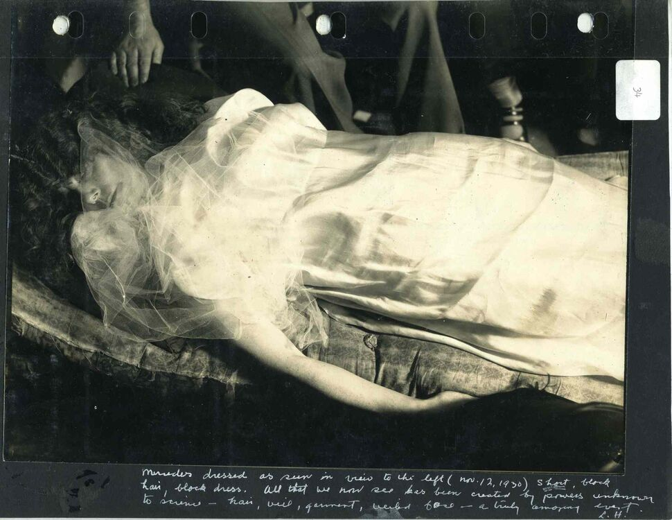 A page from an annotated photo album labeled #34 featuring a photograph of the materialization of a shiny garment and veil, via the spirit Katie King, on the medium, Mercedes, during a seance at the home of Dr. Thomas Glendenning Hamilton on February 25, 1931.  (UofM Archives/Hamilton Family fonds) ( UofM Archives/Hamilton Family fonds)