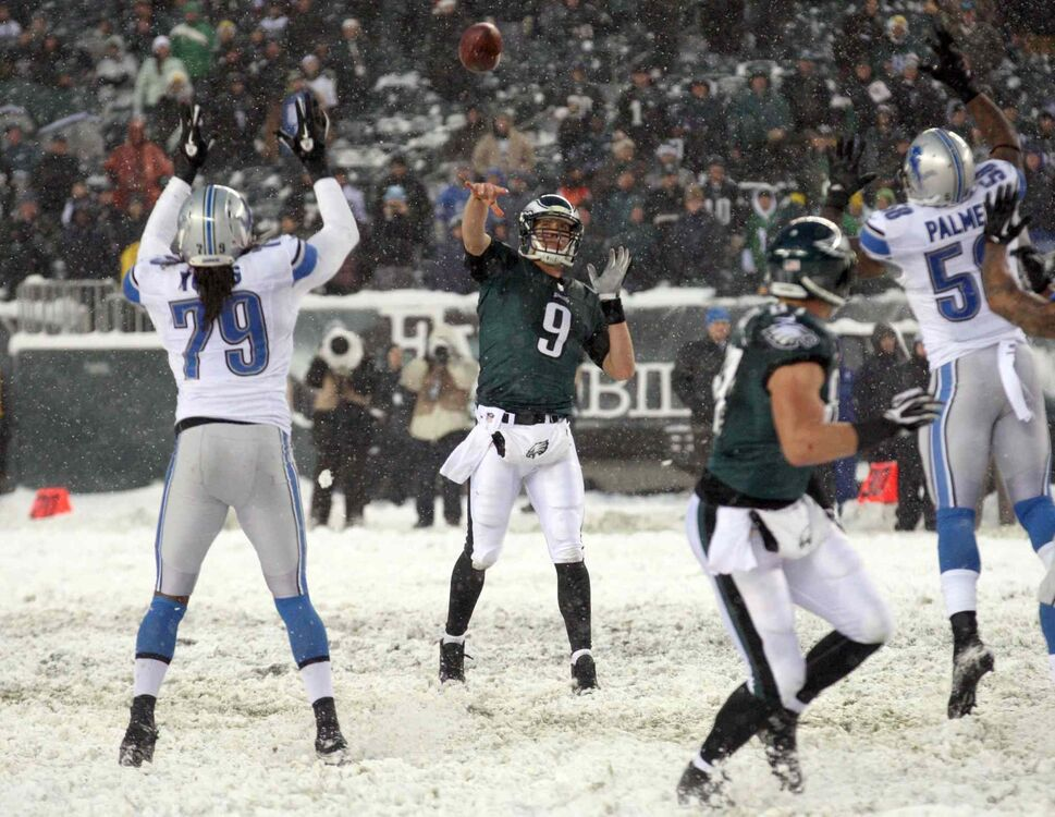 Philadelphia Eagles' Nick Foles (centre) floats the football to Brent Celek (centre right) late in the fourth quarter against the Detroit Lions at Lincoln Financial Field in Philadelphia on Sunday. (Yong Kim / Philadelphia Daily News / MCT)