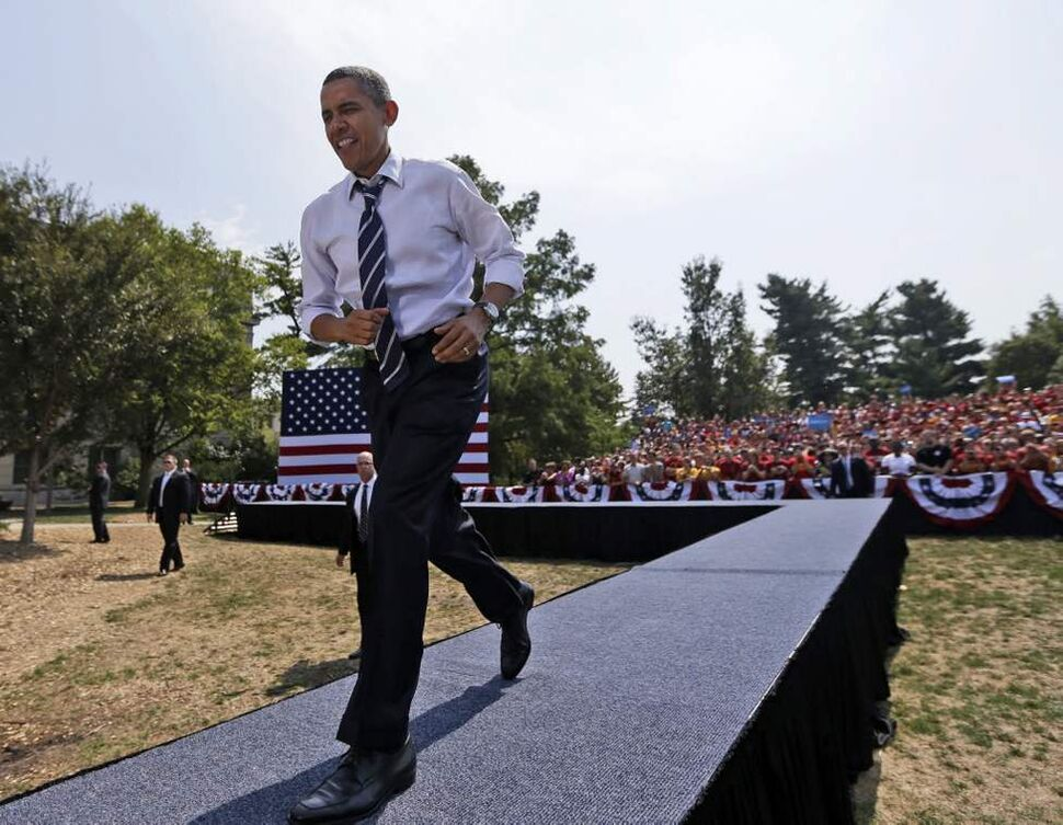 President Barack Obama walks on stage to speak for a campaign event at Iowa State University, Tuesday, Aug. 28, 2012, in Ames, Iowa. (AP Photo/Pablo Martinez Monsivais) (CP)