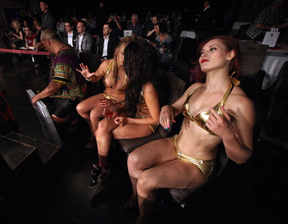 Ring girls primp between rounds at the boxing event held at Club Regent Thursday evening.  (Phil Hossack / Winnipeg Free Press)