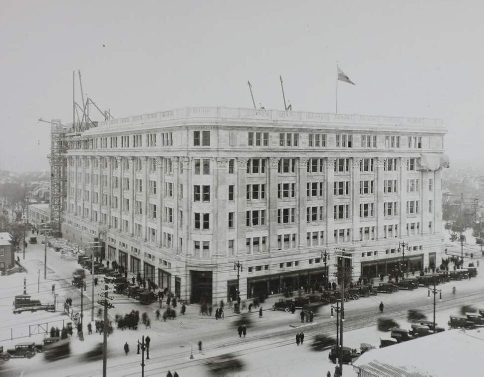 Original plans for the building's exterior called for terra cotta to be brought in from the United States. At the urging of local leaders, the Hudson's Bay Company changed its plans and agreed to use $400,000 worth of locally cut Tyndall stone. The decision not only created additional jobs in Manitoba, but allowed The Bay to later advertise that the structure was constructed with 100 per cent of Manitoba products.   (Hudson's Bay Company Archives, Archives of Manitoba)