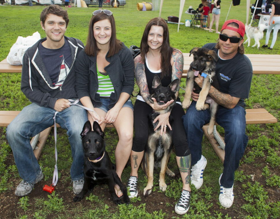Kilcona Park Dog Club Inc. held its 10th annual fundraising barbecue on June 14, 2015. Mark Malonski and Kelly Malonski with their dog, Bali, and Penny Banman and Adam Banman with their dogs, Thor and Zeus.  (JOHN JOHNSTON / WINNIPEG FREE PRESS)