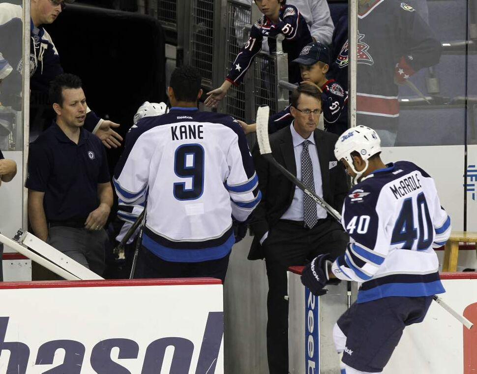 The Winnipeg Jets vs.Columbus Blue Jackets at Nationwide Arena in Columbus, Ohio. The Winnipeg Jets come off the ice under the watchful eye of owner Mark Chipman (in suit). Sept. 20, 2011 (BORIS MINKEVICH / WINNIPEG FREE PRESS)
