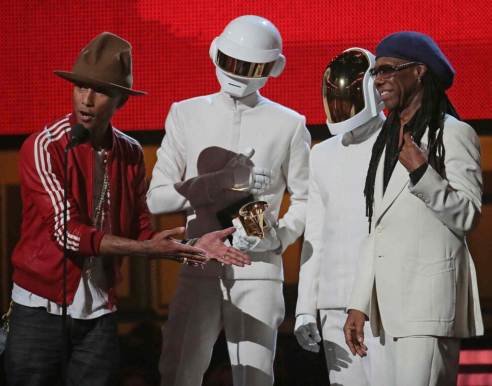 Pharrell Williams, Daft Punk duo and Nile Rogers accept the Grammy for Record of the Year at the 56th Annual Grammy Awards. (Robert Gauthier / Tribune Media / MCT)