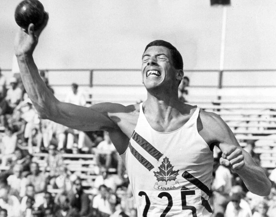 Steve Spencer of Vancouver strains every muscle in heaving the shot put in his decathlon event.  (Winnipeg Free Press Files)
